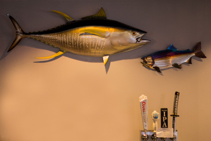 Tuna and salmon metal wall art featured at at Tiga Sushi Bar & Asian Bistro